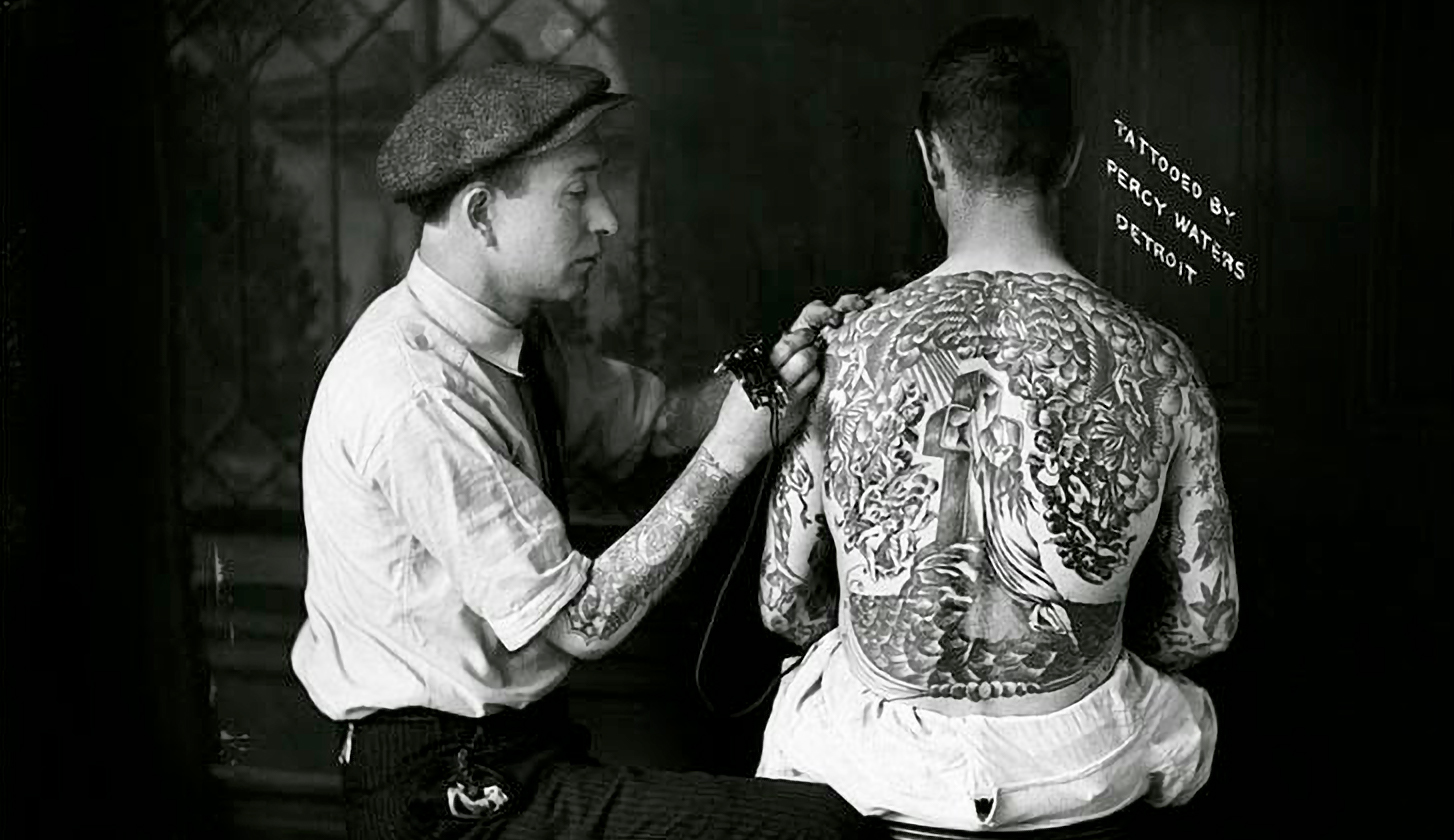 Percy Waters tattooing Rock of Ages Backpiece